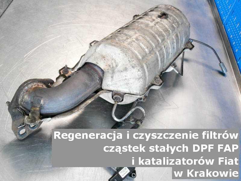 Naprawiany katalizator SCR marki Fiat, na stole, w Krakowie.