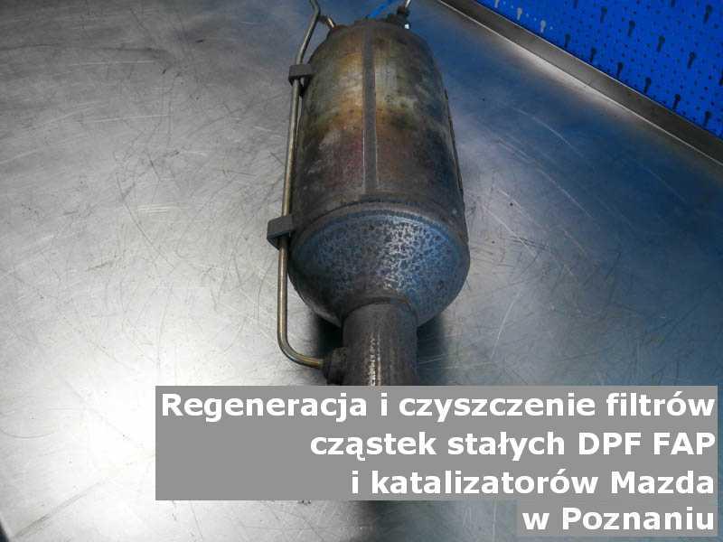 Naprawiony filtr cząstek stałych marki Mazda, na stole, w Poznaniu.