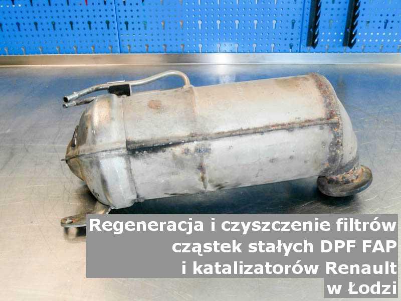 Zregenerowany filtr cząstek stałych DPF marki Renault, w warsztacie na stole, w Łodzi.